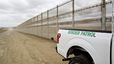 A U.S. Border Patrol vehicle sits parked next to a secondary fence along the U.S.-Mexico border in San Diego, California, U.S., on Monday, Oct. 30, 2017. President Donald Trump told a group of Republican lawmakers who met with him at the White House that he opposes any effort to include in the legislation deportation protections for 800,000 people, known as Dreamers, who entered the U.S. illegally as children, according to several who attended the meeting. Photographer: Daniel Acker/Bloomberg via Getty Images