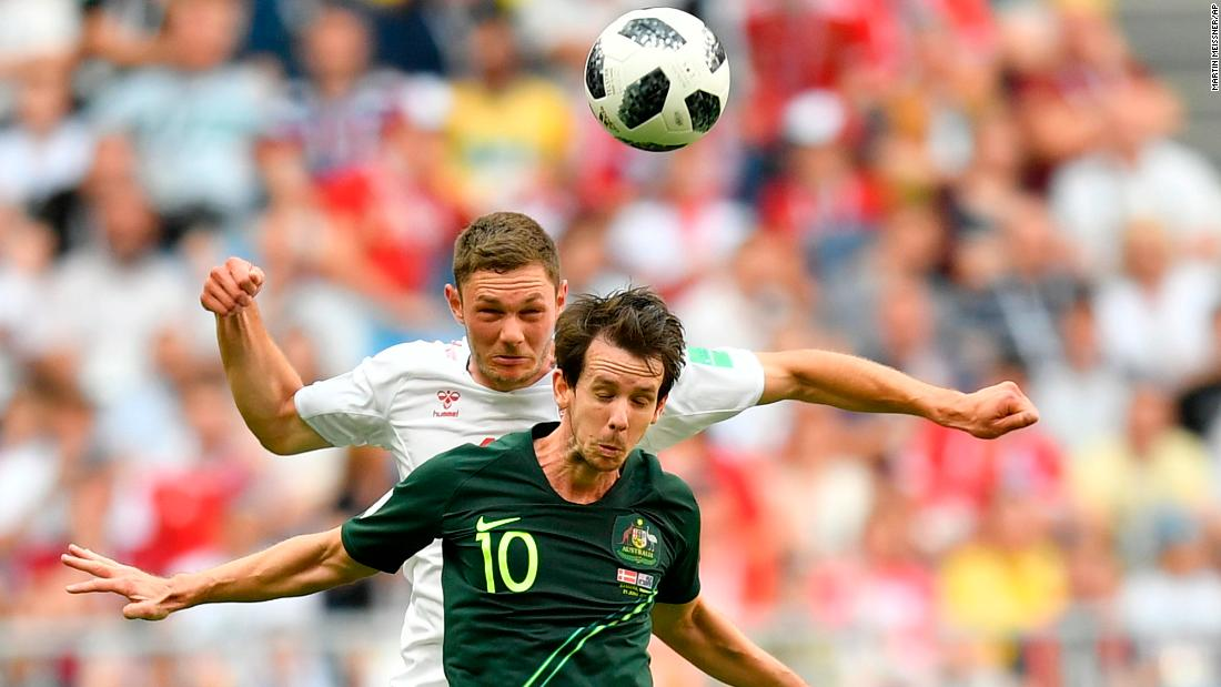 Australia's Robbie Kruse, foreground, and Denmark's Henrik Dalsgaard go for a header during the teams' 1-1 draw on June 21.