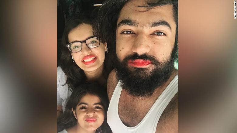 A boy was bullied for wearing lipstick. So his cousin and her family wore pink lipstick in support.
