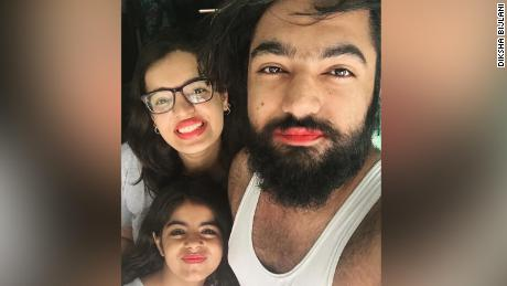 Diksha Bijlani, left, her brother Geet Bijlani, right, and another cousin, center, wear pink lipstick to support their young cousin.