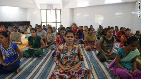 Indian visually impaired and partially visually impaired girls participate in a yoga class at Andh Kanya Prakash Gruh in Ahmedabad on June 20, 2018, on the eve of International Yoga Day.