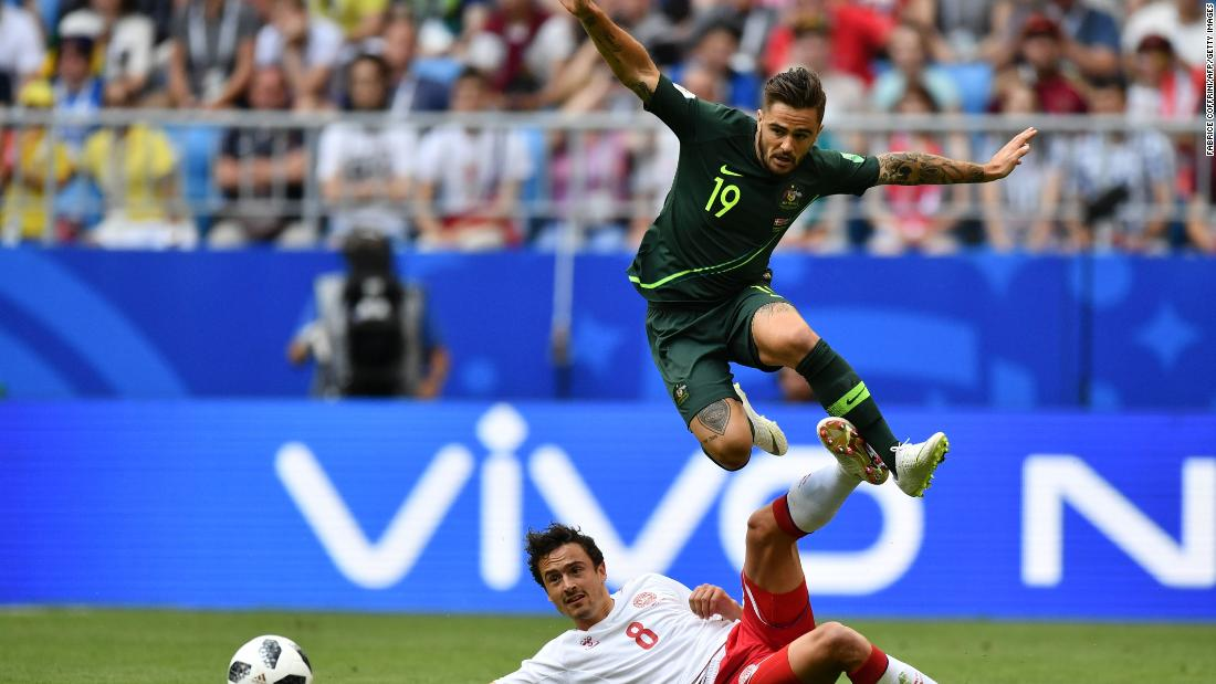 Australia's Joshua Risdon jumps over Thomas Delaney.
