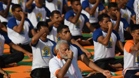Indian Prime Minister Narendra Modi leads volunteers in breathing exercises on the fourth anniversary of International Yoga Day