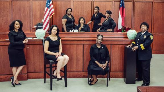These women hold the reins of power in the municipal criminal justice system of South Fulton, Georgia. Foreground, from left, LaDawn Jones, Lakesiya Cofield, Viveca Famber Powell, interim Police Chief Sheila Rogers. Background, from left, clerk Kerry Stephens, Chief Judge Tiffany Carter Sellers, clerk Ramona Howard, clerk Tiffany Kinslow