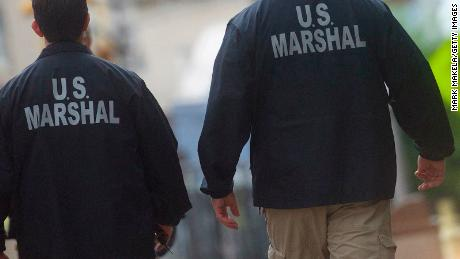 "U.S. Marshals monitor activity outside the Martin Luther King, Jr. Federal Courthouse before opening statements are heard in the ""Bridgegate"" trial on September 19, 2016 in Newark, New Jersey."