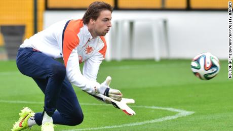 Netherlands' goalkeeper Tim Krul makes a save on the training pitch at The Estádio Paulo Machado de Carvalho (Pacaembu) in Sao Paulo on July 10, 2014, ahead of their third place play-off against host nation Brazil in the 2014 FIFA World Cup.   Despite their World Cup semi-final elimination on penalties by Argentina, the Netherlands and their coach Louis van Gaal will move on from the tournament with their reputations unquestionably enhanced. AFP PHOTO / NELSON ALMEIDA        (Photo credit should read NELSON ALMEIDA/AFP/Getty Images)