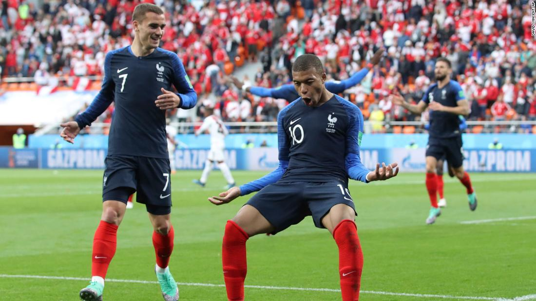 France's Kylian Mbappe, right, celebrates with teammate Antoine Griezmann after scoring against Peru on June 21. It was the only goal of the match.