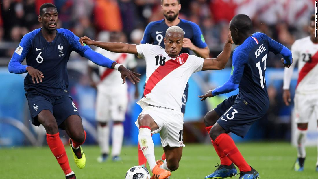 Peru's Andre Carrillo is challenged by French players Paul Pogba, left, and N'Golo Kante.