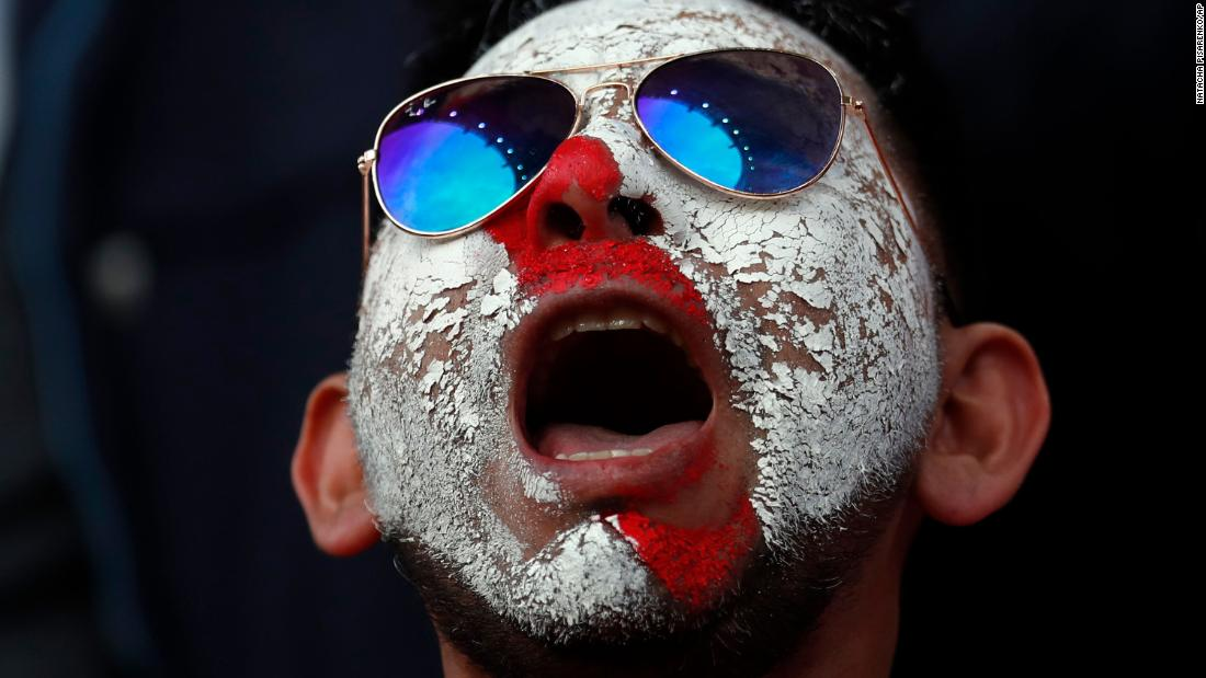 A Peruvian supporter waits for the start of the match.