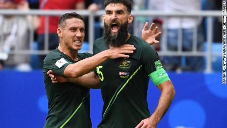 Australia's midfielder Mile Jedinak (R) celebrates scoring from the penalty spot for Australia's first goal to equalise 1-1 during the Russia 2018 World Cup Group C football match between Denmark and Australia at the Samara Arena in Samara on June 21, 2018. (Photo by MANAN VATSYAYANA / AFP) / RESTRICTED TO EDITORIAL USE - NO MOBILE PUSH ALERTS/DOWNLOADS        (Photo credit should read MANAN VATSYAYANA/AFP/Getty Images)
