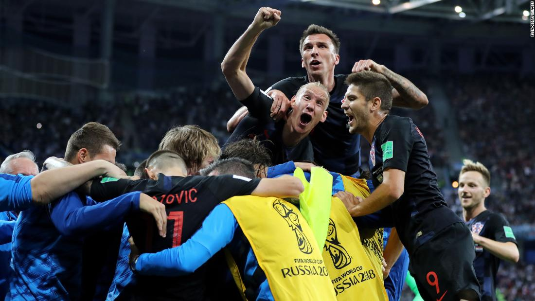 Croatian players celebrate the second goal in their 3-0 victory over Argentina on June 21. The victory clinched them a spot in the knockout stage.