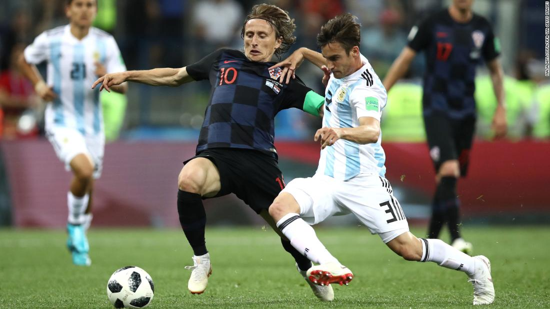 Croatia's Luka Modric is tackled by Argentina's Nicolas Tagliafico.