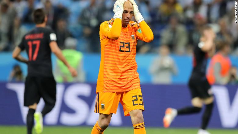 Willy Caballero puts his head in his hands after gifting Croatia the opener.