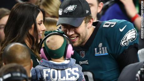 Nick and Tori Foles celebrate with baby Lily at the Super Bowl.