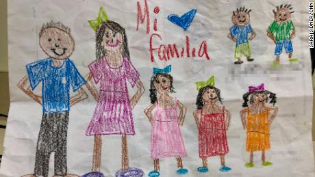 A family portrait by one of the foster children cared for by Michelle and her family.