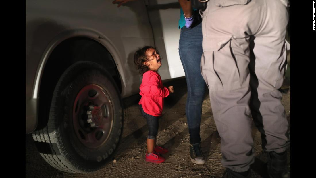 "A 2-year-old Honduran girl cries as her mother is searched and detained in McAllen, Texas, near the US-Mexico border. They had rafted across the Rio Grande and were stopped by US Border Patrol agents, according to Getty Images photographer John Moore. <a href=""https://www.cnn.com/interactive/2018/06/us/crying-girl-john-moore-immigration-cnnphotos/"" target=""_blank"">The photo went viral this past week</a> as an example of the Trump administration's new ""zero-tolerance"" immigration policy. The administration has said it will refer everyone caught crossing the border illegally for prosecution, even if they are claiming to deserve asylum or have small children."