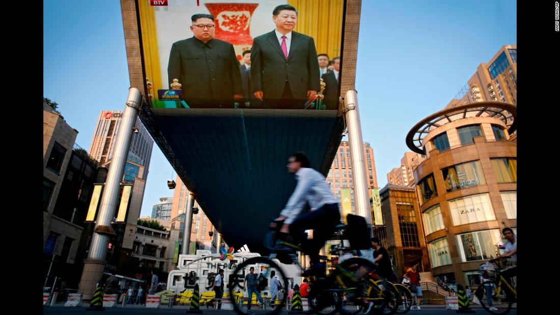 "A giant television screen in Beijing broadcasts<a href=""https://www.cnn.com/2018/06/18/asia/kim-jong-un-china-intl/index.html"" target=""_blank""> the meeting of Chinese President Xi Jinping and North Korean leader Kim Jong Un</a> on Tuesday, June 19. It was their third meeting in as many months. According to state media, the two men agreed they wanted to further deepen the already-close ties between Beijing and Pyongyang."