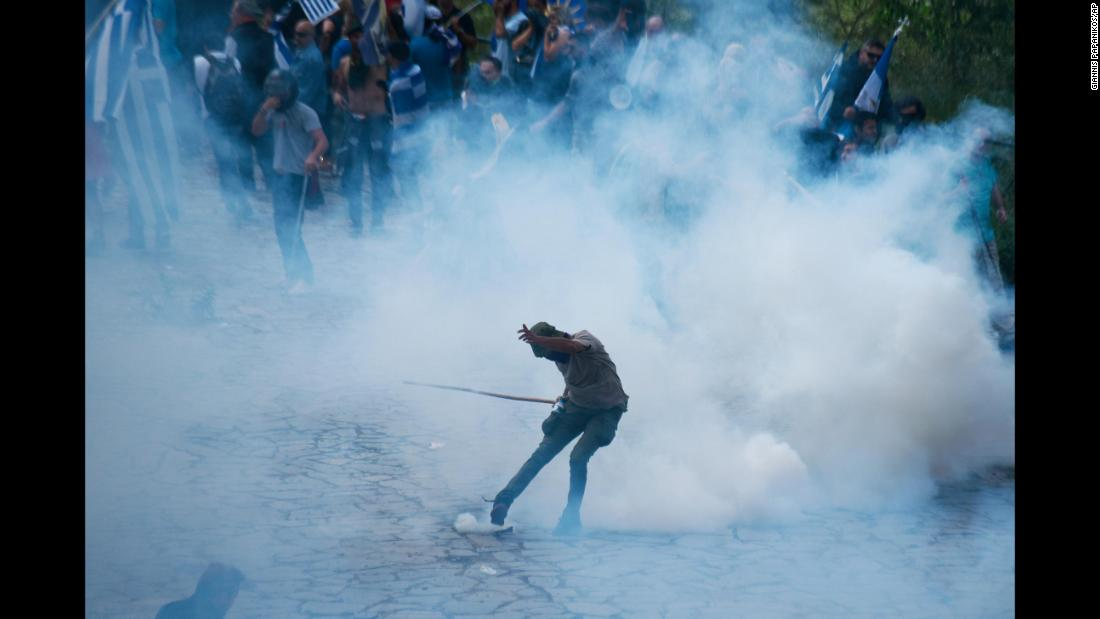 "A protester kicks a tear-gas canister thrown by police during clashes in Pisoderi, Greece, on Sunday, June 17. Greece and Macedonia <a href=""https://www.cnn.com/travel/article/macedonia-changes-name-intl/index.html"" target=""_blank"">signed a historic agreement</a> to rename the latter the Republic of North Macedonia, possibly putting end to a dispute that has soured relations between the two countries for decades. But not everyone is happy with the deal."