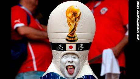 TOPSHOT - A disguised Japanese fan sticks out his tongue before the Russia 2018 World Cup Group H football match between Colombia and Japan at the Mordovia Arena in Saransk on June 19, 2018. (Photo by JUAN BARRETO / AFP) / RESTRICTED TO EDITORIAL USE - NO MOBILE PUSH ALERTS/DOWNLOADS        (Photo credit should read JUAN BARRETO/AFP/Getty Images)