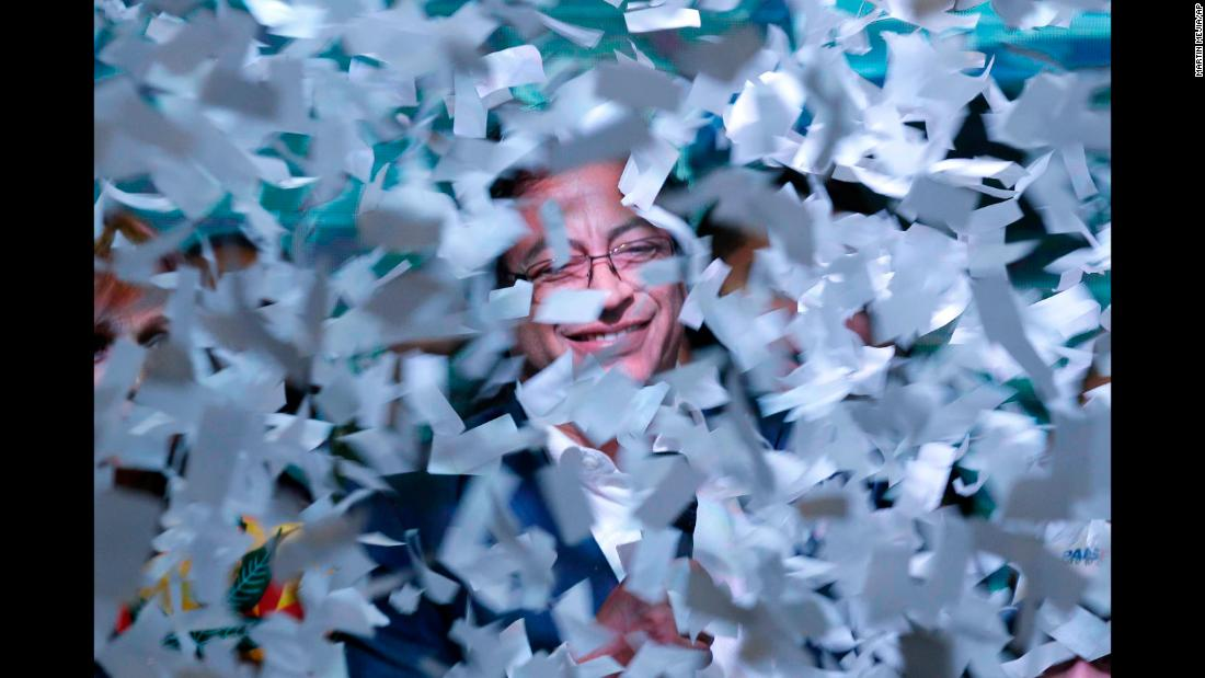 "Colombian presidential candidate Gustavo Petro is surrounded by ticker tape while speaking to supporters in Bogota, Colombia, on Sunday, June 17. Petro, the mayor of Bogota, <a href=""https://www.cnn.com/2018/06/17/americas/colombia-runoff-election/index.html"" target=""_blank"">lost to Ivan Duque.</a>"