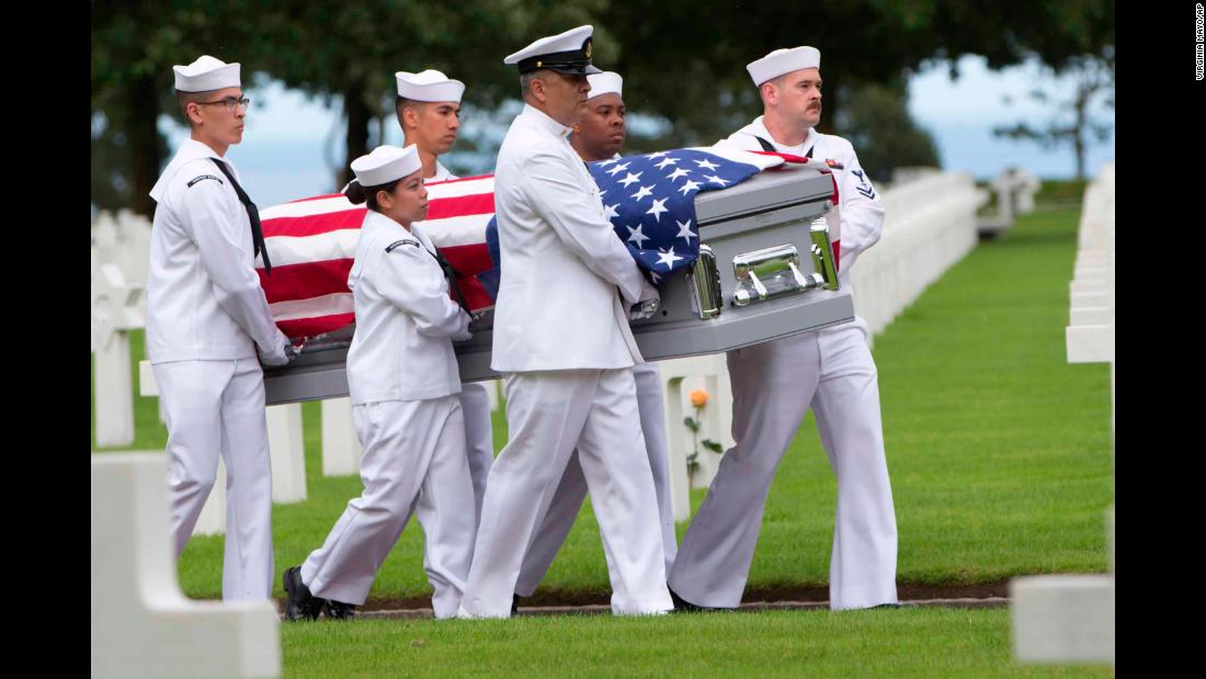 "US Navy personnel carry the casket of Julius Pieper, a sailor who died in World War II, during a reburial service in Colleville-sur-Mer, France, on Tuesday, June 19. Pieper was being reunited with his twin brother, Ludwig, <a href=""https://www.cnn.com/2018/06/21/us/world-war-ii-twins-reunited-74-years-later-trnd/index.html"" target=""_blank"">74 years after their ship hit a mine</a> off the coast of Normandy."