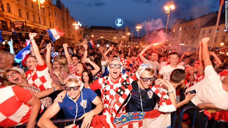Croatia's fans watch their team's victory on a giant screen in Zagreb.