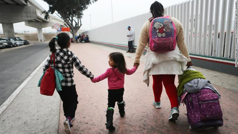 TIJUANA, MEXICO - JUNE 21:  A migrant mother walks with her two daughters on their way to cross the port of entry into the U.S. for their asylum hearing on June 21, 2018 in Tijuana, Mexico. The mother, who did not wish to give their names, said they were fleeing their hometown near the Pacific coast of Mexico after suffering a violent carjacking of her taxicab. The Trump Administration's controversial zero tolerance immigration policy led to an increase in the number of migrant children who have been separated from their families at the southern U.S. border. U.S. Attorney General Jeff Sessions has added that domestic and gang violence in immigrants' country of origin would no longer qualify them for political asylum status.  (Photo by Mario Tama/Getty Images)