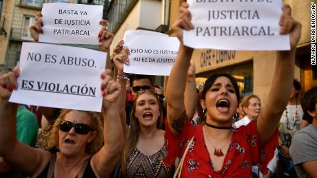 People hold up signs reading, ''It is not an abuse. It's rape'', left, and ''Enough of patriarchal justice'' while protesting against sexual abuse sentence, in Pamplona, northern Spain, Thursday, June 21, 2018. A Spanish court triggered a new wave of outrage Thursday by granting bail to five men acquitted of gang rape and convicted instead on a lesser felony of sexual abuse. It was not clear when the men might leave prison.(AP Photo/Alvaro Barrientos)