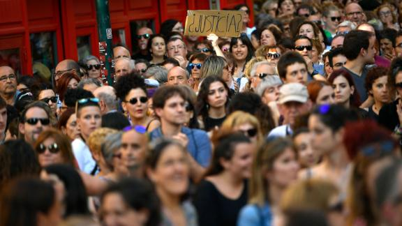 A woman holds up a sign reading ''Justice?'' at a protest Thursday in Pamplona.