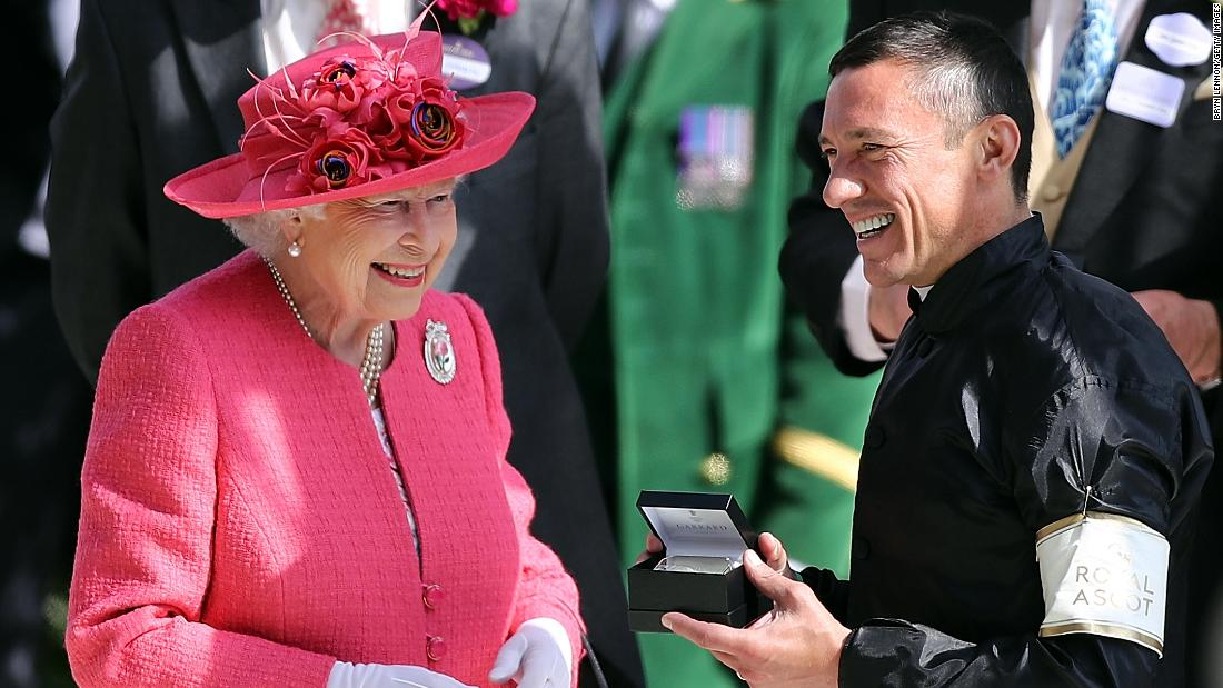 The Queen presented the silverware to the colorful Dettori as well as winning trainer John Gosden.