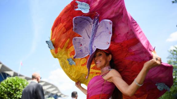 ASCOT, ENGLAND - JUNE 21:  A racegoer wears an outsize hat for Ladies Day during Royal Ascot Day 3 at Ascot Racecourse on June 21, 2018 in Ascot, United Kingdom. Royal Ascot is Britain