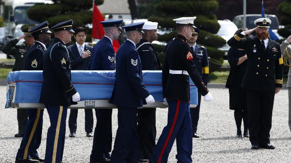 United Nations Command (UNC) honour guards carry a casket containing the remains of a UNC  soldier killed inside North Korea during the 1950-53 Korean War, during a joint repatriation ceremony at Knight Field at Yongsan garrison in Seoul on April 28, 2016.  The repatriation ceremony was held for the remains of two United Nations Command soldiers and 15 South Korean soldiers who fought during the Korean War against the North Korean army backed by Chinese soldiers. The remains were recovered in several locations, including Kujang/Unsan and the east side of the Chosin Reservoir, areas where the US 2nd and 7th Infantry Divisions fought during the Korean war.   / AFP / POOL / JEON HEON-KYUN        (Photo credit should read JEON HEON-KYUN/AFP/Getty Images)