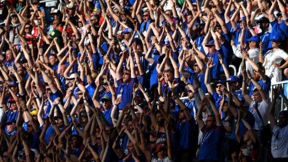 Iceland fans perform their famous viking clap.
