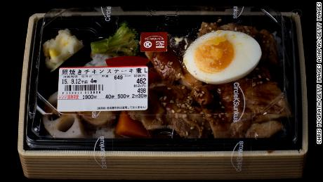 "TOKYO, JAPAN - SEPTEMBER 11: A bento box containing grilled chicken and vegetables from a convenience store or ""konbini"" is pictured on September 11, 2015 in Tokyo, Japan. Japan's Konbini stores (convenience stores) are famous for their high quality food, available 24hours a day. Many of the stores have 2-5 deliveries per day of fresh, often locally sourced products all prepared in ready to eat packaged meals, catering mostly to office workers and travellers. As of July 30, 2015, Japan's minimum wage was 780yen (approx. $6.45 USD) lower than in many countries, including the United States. With a small 2.3 percent rise in minimum wages expected this year, the cheap convenience store meals popularity has seen a steady rise in sales, fast food and daily food sales of convenience stores for 2014 was 3,807,614 million yen, according to the Ministry of Economy, Trade and Industry.  (Photo by Chris McGrath/Getty Images)"