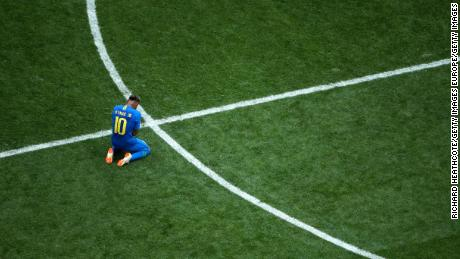 An emotional Neymar hid his head in his hands at the final whistle.