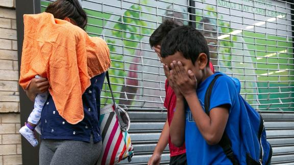 Groups of children being dropped off at Manhattan foster care agency, which Mayor Bill de Blasio says houses more than 200 migrant children. It's unclear whether the children in the photo, who cover their faces, are among those separated from their parents.