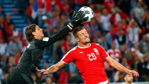 Swiss goalkeeper Yann Sommer catches the ball over Milinkovic-Savic.