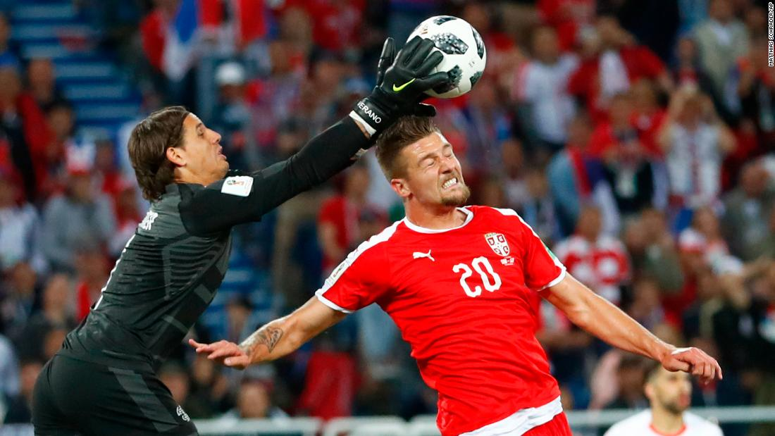 Swiss goalkeeper Yann Sommer catches the ball over Milinkovic-Savic.