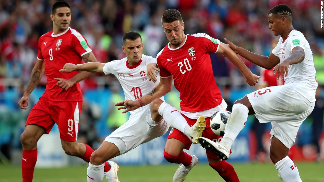 Swiss players defend Serbia's Sergej Milinkovic-Savic.