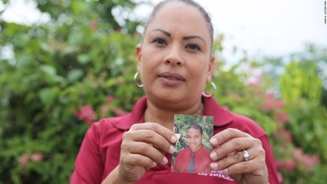 """Daniel Vick's mother, Margarita Rodriguez, holds a photo of her son, whose death was labeled """"leptospirosis"""" in a database obtained by CNN and CPI."""