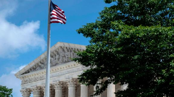 WASHINGTON, DC - JUNE 21: The U.S. Supreme Court is seen behind trees after it ruled that states may collect s
