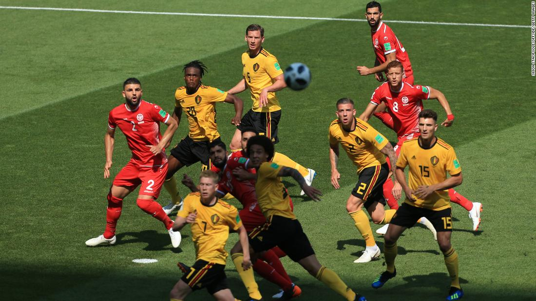Players watch the ball during a match between Belgium and Tunisia.