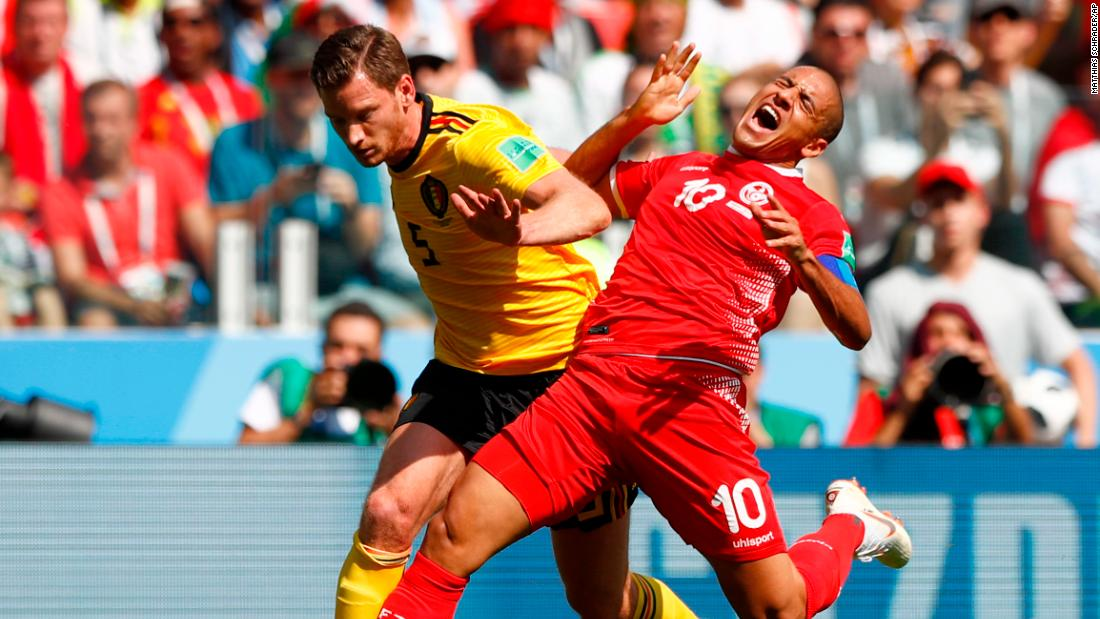 Belgium's Jan Vertonghen, left, and Tunisia's Wahbi Khazri challenge for the ball.