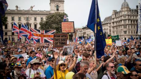 Marchers gather in London's Parliament Square to take part in the People's Vote demonstration.