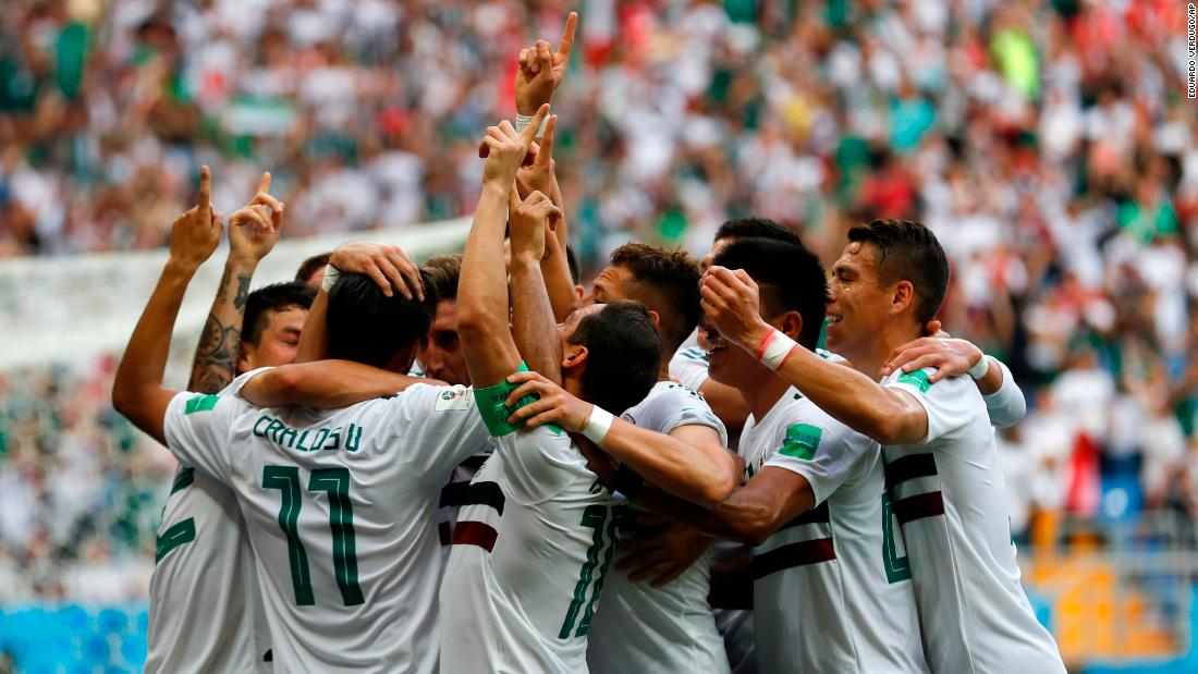 Mexico celebrates after Carlos Vela scored the team's opening goal against South Korea.