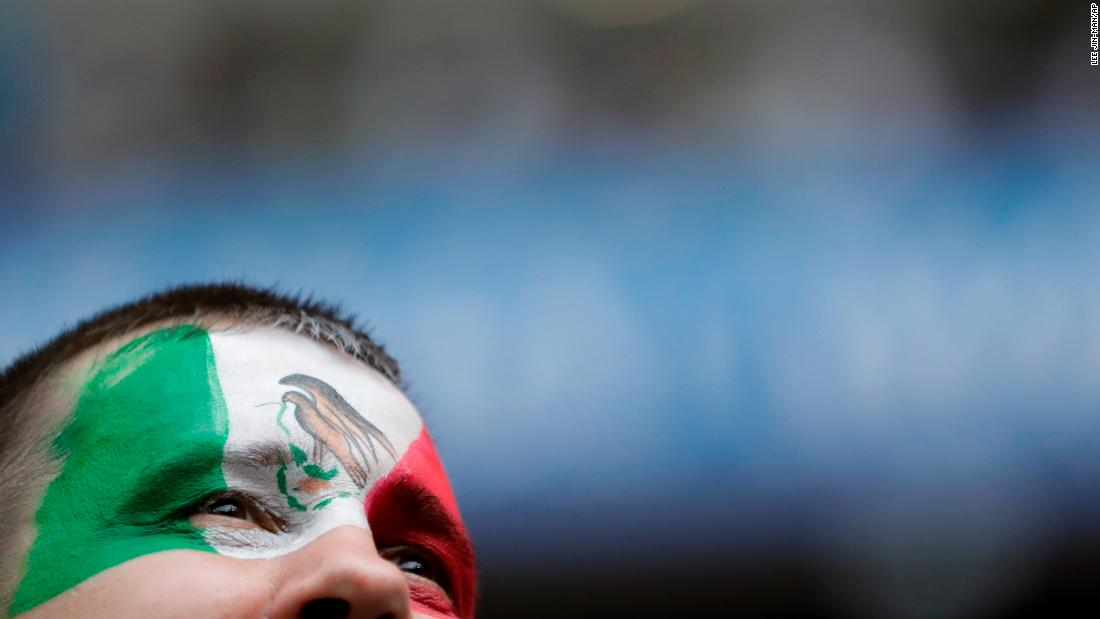 A Mexican fan waits for the start of the Group F match against South Korea.