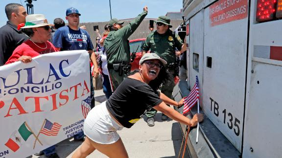 Demonstrator Martha Mercado tried to stop a bus with immigrant children outside a Border Patrol processing center in McAllen, Texas.