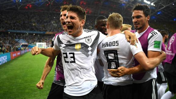German players celebrate after Toni Kroos scored on a late free kick to stun Sweden 2-1 on June 23.