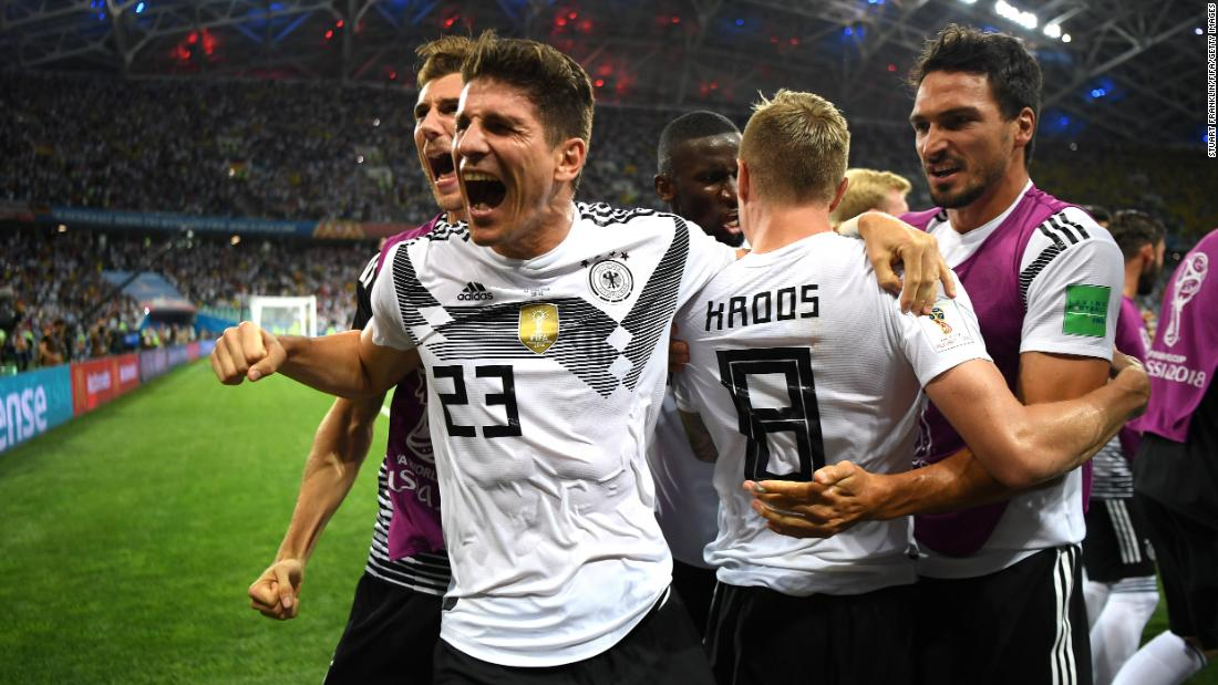 Toni Kroos of Germany celebrates with Mario Gomez, left, after scoring his team's winning goal against Sweden on Saturday, June 23.