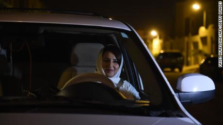 Saudi Samar Almogren prepares to drive her car through Riyadh city's streets for the first time just after midnight, June 24, 2018, when the law allowing women to drive took effect.